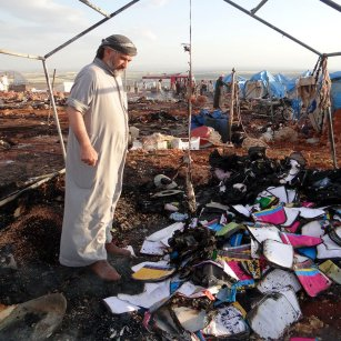 People inspect the damage after a Syrian regime warplane targeted the Kamuna refugee camp near the Idlib province on May 05, 2016. 8 people were killed and another 30 injured. Image by Anadolu
