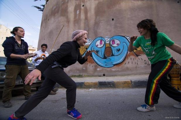 Daniah and Kasandra as they play capoeira [photo: Maria de la Guardia]