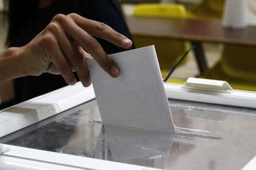 a-palestinian-student-casts-their-ballot-at-the-Birzeit-University-Student-Counil-election