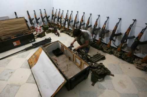 A rebel fighter arranges weapons in Aleppo, Syria on September 26 2016 [REUTERS/Khalil Ashawi]