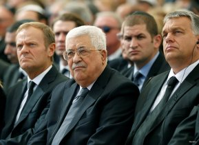 Palestinian President Mahmoud Abbas (C) sits alongside European Council President Donald Tusk (L) as they attend the funeral of Shimon Peres, 93, on Mount Herzl Cemetery in Jerusalem, September 30, 2016. REUTERS/Abir Sultan/Pool