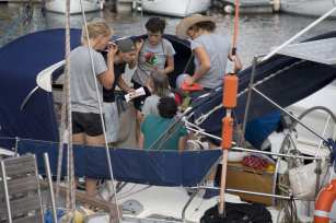 """BARCELONA, SPAIN - SEPTEMBER 14: Activists of Two sailing boats, Amal-Hope and Zaytouna-Oliva, with only female activists on board, make preparations before set off for the Gaza Strip from the port of Barcelona under the banner """"The Women's Boat to Gaza"""" to break the Israeli blockade on Gaza on September 14, 2016 in Barcelona, Spain. ( Albert Llop - Anadolu Agency )"""