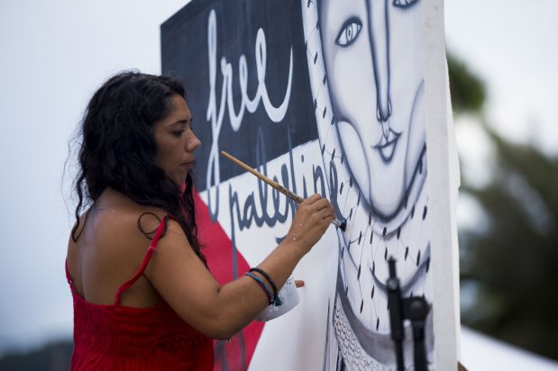 "BARCELONA, SPAIN - SEPTEMBER 14: A woman artist paints a mural in support to the Women Peace Flotilla, two sailing boats named Amal-Hope and Zaytouna-Oliva, with only female activists on board, before it sets off for the Gaza Strip from the port of Barcelona under the banner ""The Women's Boat to Gaza"" to break the Israeli blockade on Gaza on September 14, 2016 in Barcelona, Spain. ( Albert Llop - Anadolu Agency )"