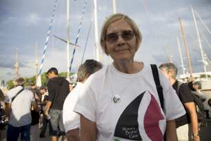 """Ann Wright, member of the crew of Amal-Hope and Zaytouna-Oliva, with only female activists on board, poses before set off for the Gaza Strip from the port of Barcelona under the banner """"The Women's Boat to Gaza"""" to break the Israeli blockade on Gaza on September 14, 2016 in Barcelona, Spain. ( Albert Llop - Anadolu Agency )"""