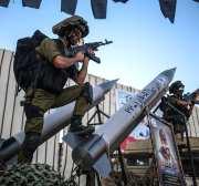RAFAH, WEST BANK - SEPTEMBER 26 :  People attend the Al-Nasser Salah al-Deen Brigades' parade during the presentation of Al-Nasser Salah al-Deen Brigades' 2 new missiles in Rafah, West Bank on September 26, 2016. ( Ali Jadallah - Anadolu Agency )