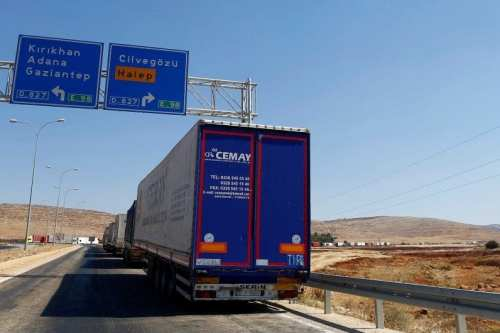 Image of Turkish trucks waiting the Syrian border in Turkey, September 16, 2016 [REUTERS/Osman Orsal]