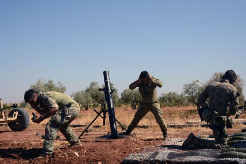 Free Syrian Army (FSA) members use howitzers to shell Daesh positions around Tilalin village during 'Operation Euphrates Shield' in Aleppo, Syria on September 27, 2016