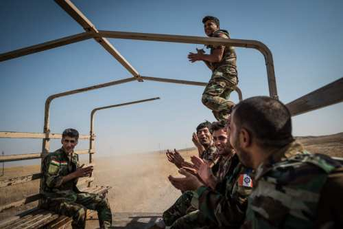 Fighters of the Iranian based Kurdistan Freedom Party (PAK) singing during a frontline leave in Mosul, Iraq ([Alex Kühni]