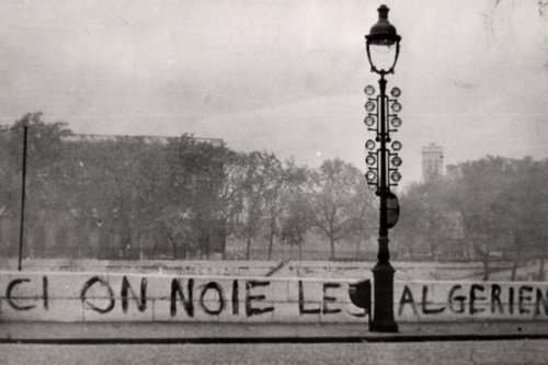 """Tagged on the Saint-Michel Bridge in 1961: """"Ici on noie les Algériens"""" (""""Here we drown Algerians""""). Dozens of bodies were later pulled from the River Seine. [Wikipedia]"""