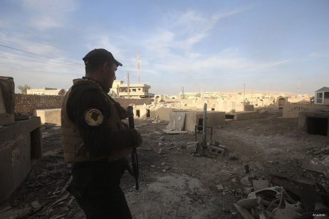 Iraqi security forces patrol Bertilla town during an operation to liberate Mosul from Daesh terrorists [Anadolu]
