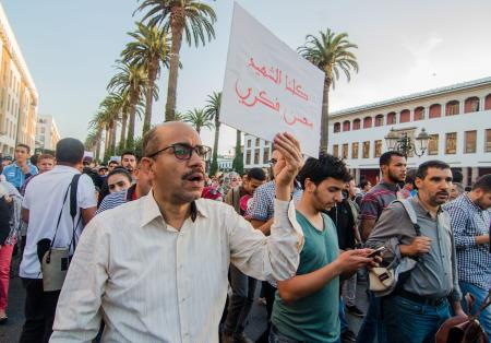 RABAT, MOROCCO - OCTOBER 30: Moroccans stage a protest in front of Internal Ministry in Rabat, Morocco, after a fisherman Mohcine Fikri, was crushed to death in a garbage truck. ( Jalal Morchidi - Anadolu Agency)