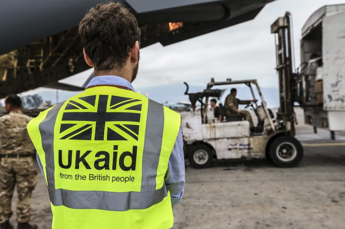 A DFID staff member supervises the unloading of UK Aid from a RAF C-17 aircraft in Nepal on the 29 April 2015. [DFID / Sgt Neil Bryden RAF]