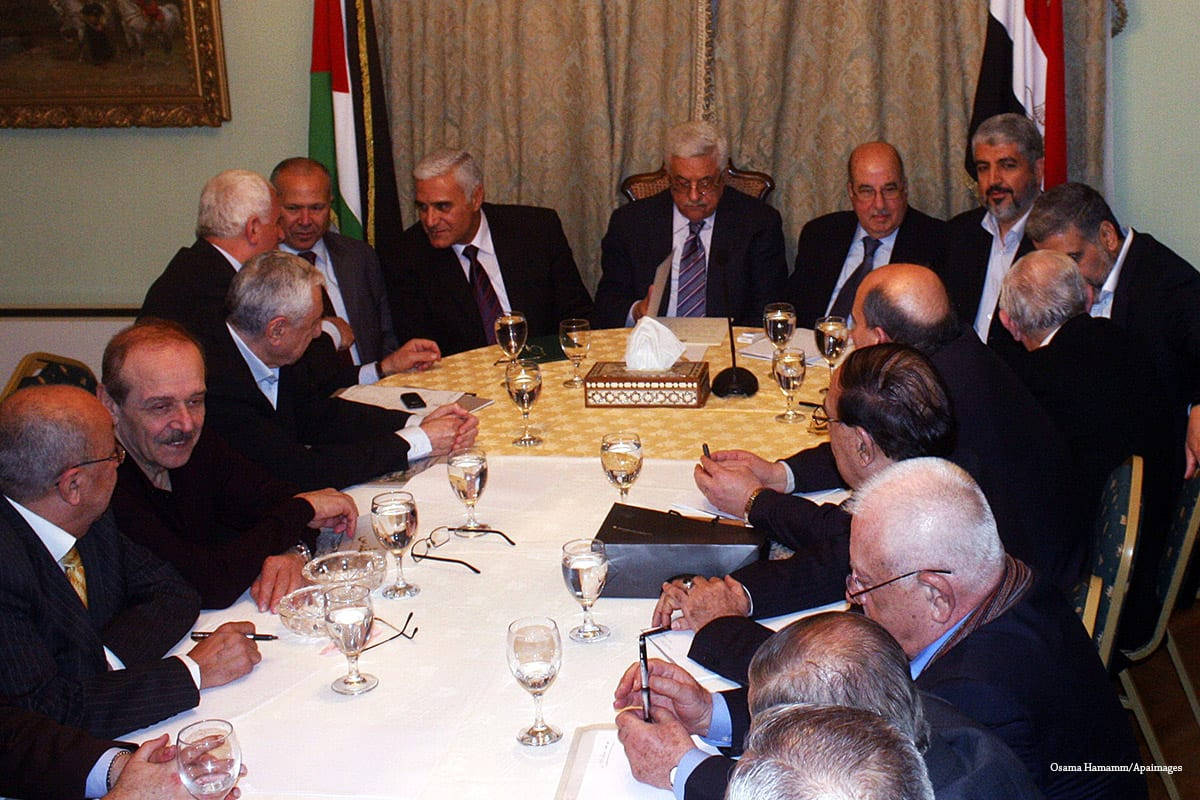 Palestinian President Mahmoud Abbas, and Hamas leader Khaled Meshaal, during a meeting between Fatah and Hamas in Cairo, Egypt [Osama Hamamm/Apaimages]