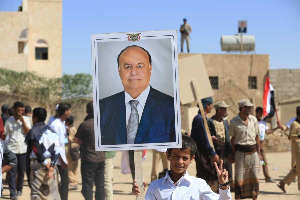 MA'RIB, YEMEN - 3 NOVEMBER: Supporters of Legal Government hold the portraits of Yemeni President Abd Rabbuh Mansur Hadi during a protest against the Yemen peace plan proposed by the UN Special Envoy for Yemen, Ismail Ould Cheikh Ahmed in Ma'rib, Yemen on 3 November, 2016. [Ali Owidha/Anadolu Agency]