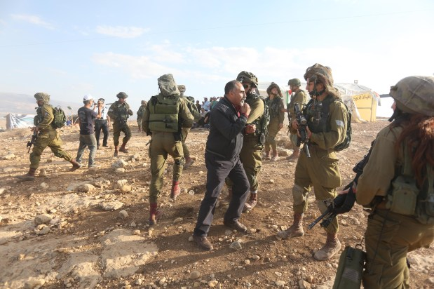 Israeli security forces intervene Palestinian protesters with real and plastic bullets and tear gas during a demonstration at the symbolic region named 'Yasser Arafat Village' in Al-Agvar region of Jericho, West Bank on November 17, 2016. ( Issam Rimawi - Anadolu Agency )