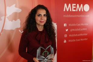 Anaheed Al-Harden seen at the Palestine Book Awards 2016 with her award for the book 'Palestinians in Syria' [Middle East Monitor]
