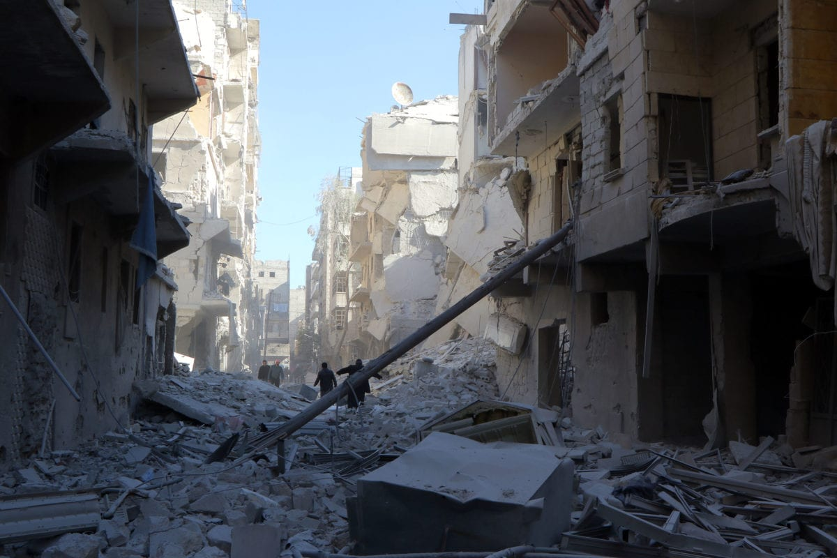 Debris of the collapsed buildings are seen after the Syrian and Russian armies carried out airstrikes in Aleppo, Syria on 23 November 2016 [Ibrahim Ebu Leys/Anadolu Agency]