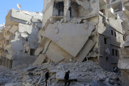 Debris of the collapsed buildings are seen after the Syrian carried out airstrikes in Aleppo, Syria on 23 November 2016 [Ibrahim Ebu Leys / Anadolu Agency]