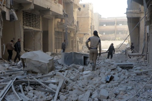 Debris of the collapsed buildings are seen after the Syrian and Russian armies carried out airstrikes on the residential areas in Aleppo, Syria on November 23 2016 [Ibrahim Ebu Leys / Anadolu Agency]