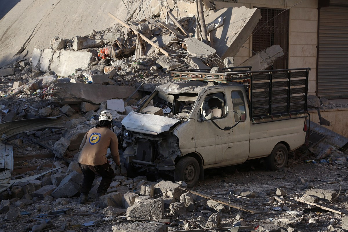 Debris of the collapsed buildings are seen after the Syrian and Russian armies carried out airstrikes in Syria [Ibrahim Ebu Leys / Anadolu Agency]