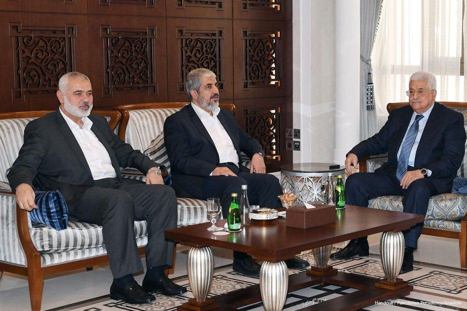 Palestinian President Mahmoud Abbas (R) meets with the Chairman of the Hamas Political Bureau, Khaled Mashal (C) and the vice Chairman of the Hamas Political Bureau, Ismail Haniyeh (L) in Doha, Qatar on October 28, 2016.