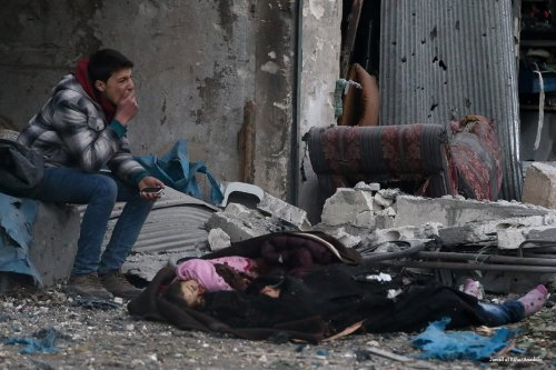 A Syrian man cries near the dead body of a girl and a woman after the Assad Regime forces carried out airstrikes in Aleppo, Syria on November 30 2016 [Jawad al Rifai/Anadolu]