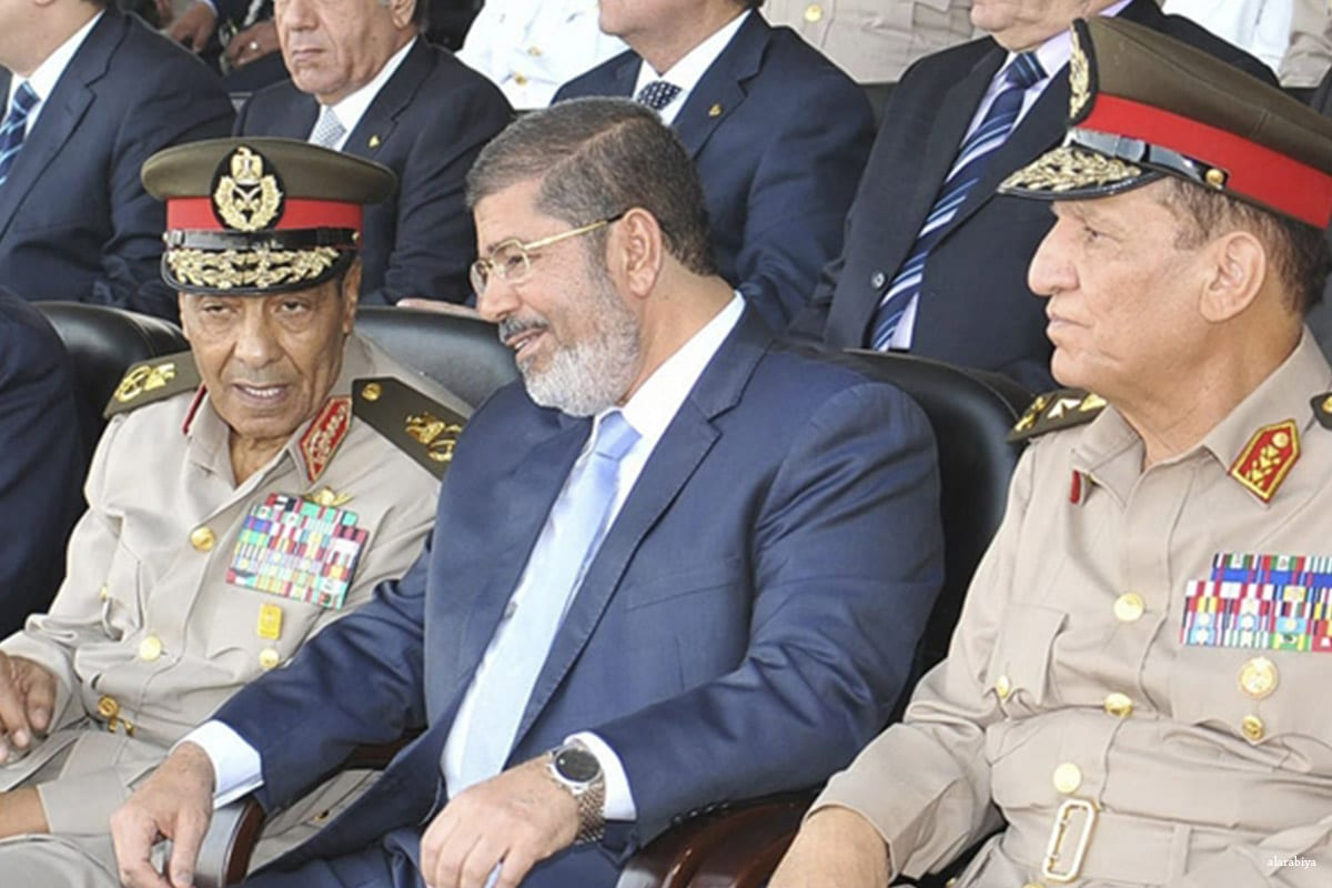 Former President Mohamed Morsi (C) seen with Field Marshal Hussein Tantawi (L) and Egyptian Armed Forces Chief of Staff Sami Anan, before the military coup against him, on 12 August 2012 [alarabiya]