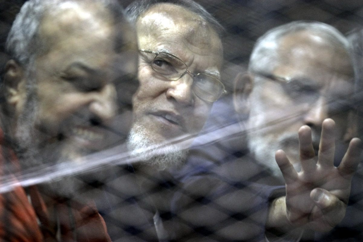 Mohammad Badi (L), head of the Muslim Brotherhood Guidance Council, Muhammed el-Biltaci (R), one of the Muslim Brotherhood Leaders, and Muslim Brotherhood member Essam Al-Aryan (C) are seen inside the defendants' cage during the trial known as ''Bahr Al-Azam'' case, in Cairo, Egypt on 24 November 2016. [Moustafa Elshemy - Anadolu Agency]