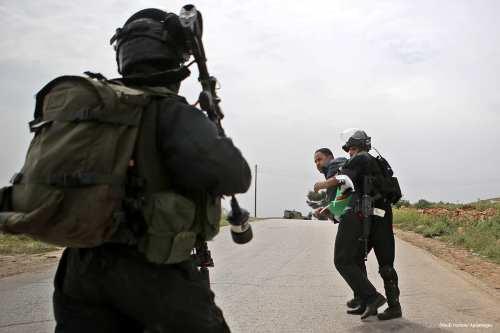 Image of Israeli security forces arresting a Palestinian protester [Shadi Hatem/Apaimages]