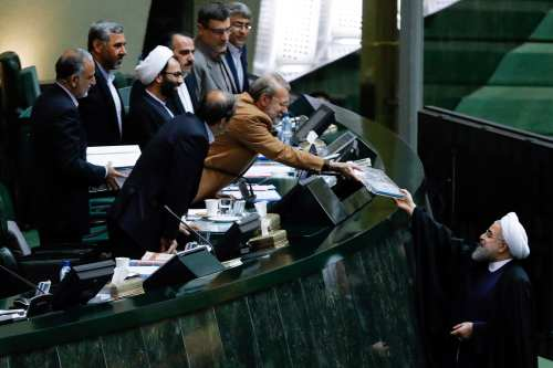 Iranian President Hassan Rouhani attends the parliament session to present the Iranian New Year budget in Tehran, Iran 4th December 2016 [Fatemeh Bahrami / Anadolu Agency ]