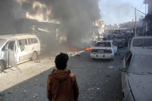 Smoke rises after Assad Regime forces carried out an airstrike over a market in Idlib, Syria on December 4 2016 [Bilal Baioush /Anadolu Agency]