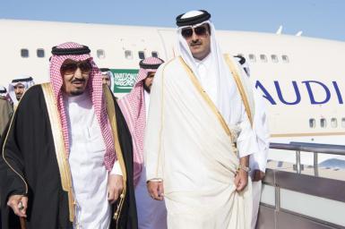 King of Saudi Arabia Salman Bin Abdulaziz (L) is welcomed by Emir of Qatar Sheikh Tamim bin Hamad Al Thani (R) at Hamad International Airport in Doha, Qatar on December 5, 2016. [Bandar Algaloud/Saudi Kingdom/Handout]