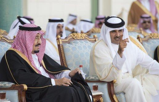 DOHA, QATAR - DECEMBER 5: King of Saudi Arabia Salman bin Abdulaziz (L) is welcomed with an official ceremony by Emir of Qatar Sheikh Tamim bin Hamad Al Thani (R) at Royal Palace in Doha, Qatar on December 5, 2016. ( Bandar Algaloud/ Saudi Kingdom/ Handout - Anadolu Agency )