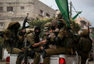 BEIT LAHIA, GAZA - DECEMBER 8 : Izz ad-Din al-Qassam Brigades, military wing of the Palestinian Hamas attend a military parade during the 29th anniversary of Hamas in Beit Lahia, Gaza on December 8, 2016. ( Mustafa Hassona - Anadolu Agency )