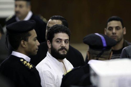 Osama Mohamed Morsi, the son of ousted Egyptian president Mohamed Morsi is seen during the trial over the breaking up the Rabaa Al-Adawiyyah protests, at the police academy in Cairo, Egypt on December 10, 2016 [Moustafa Elshemy / Anadolu Agency]