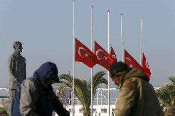 Turkish flags fly at half mast during a day of national mourning after the terror attacks near the Vodafone Arena in Istanbul's Besiktas, Turkey on December 11, 2016 [Cem Öksüz / Anadolu Agency]