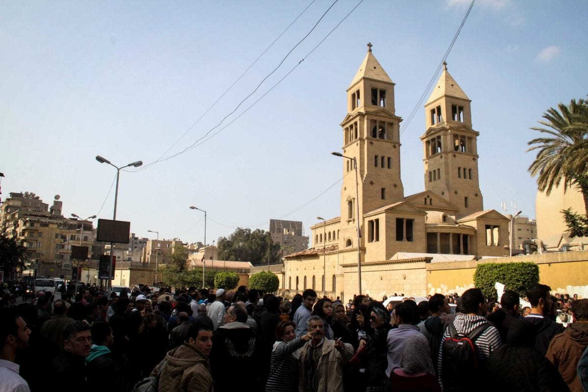 People gather at the site after an explosion at Saint Mark's Coptic Orthodox Cathedral in Cairo, Egypt on December 11 2016 [Ahmed Gamil /Anadolu Agency]