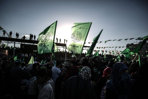 Thousands of people gather to celebrate the 29th anniversary of the foundation of Hamas in Khan Yunis, Gaza on December 11 2016 [Ali Jadallah / Anadolu Agency]