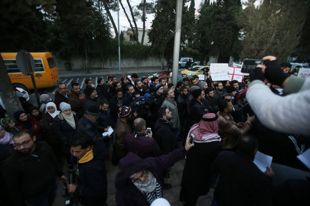 AMMAN, JORDAN - DECEMBER 13: A group of people gathered in front of the Russian Embassy shout slogans as they protest Assad regime forces' and its supporters' attacks on civilians and the humanitarian plight in Aleppo, on December 13, 2016 in Amman, Jordan. ( Salah Malkawi - Anadolu Agency )