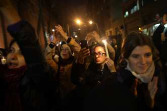 NEW YORK, UNITED STATES - DECEMBER 13: People light candles and hold posters next to Russian Federation consulate general, during a demonstration to protest Assad regime forces' and its supporters' attacks on civilians and the humanitarian plight in Aleppo, on December 13, 2016 in New York, United States. ( Mohammed Elshamy - Anadolu Agency )