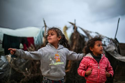Palestinian children play outside of makeshift homes in Gaza Strip on December 14 2016 [Mustafa Hassona / Anadolu Agency]