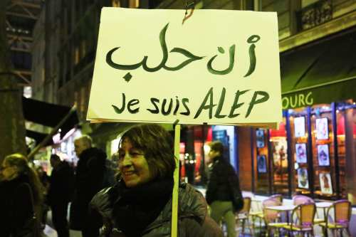 A group of people gather during a protest against Assad regime forces' and its supporters' attacks on civilians and the humanitarian plight in Aleppo, on December 14, 2016 in Paris, France [Mustafa Sevgi / Anadolu Agency]