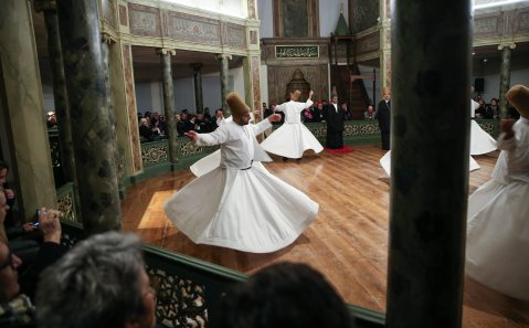 """ISTANBUL, TURKEY - DECEMBER 15 : Whirling dervishes perform during the """"Seb-i Arus"""" (The Night of union) ceremony at Galata lodge used by mevlevi dervishes to mark the 743rd anniversary of the death of Mevlana Jalaluddin al-Rumi in Istanbul, Turkey on December 15, 2016. ( Berk Özkan - Anadolu Agency )"""