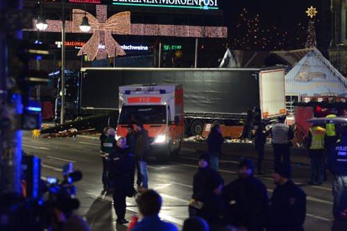 Paramedics and police arrive at a scene where a truck ploughed into a Christmas market in Berlin, Germany on December 19 2016 [Maurizio Gambarini /Anadolu Agency]