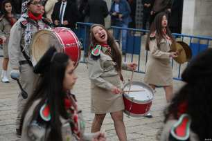 Palestinian marching band parade near the Church of the Nativity ahead of the Christmas in Bethlehem, West Bank on December 24, 2016 [Issam Rimawi / Anadolu Agency]