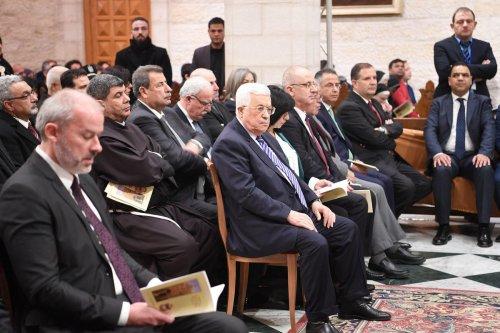 Palestinian President Mahmoud Abbas (C) attends a Christmas Eve mass at El Mehd Church in Bethlehem, West Bank on December 25, 2016 [Osama Falah / Palestinian Presidency]