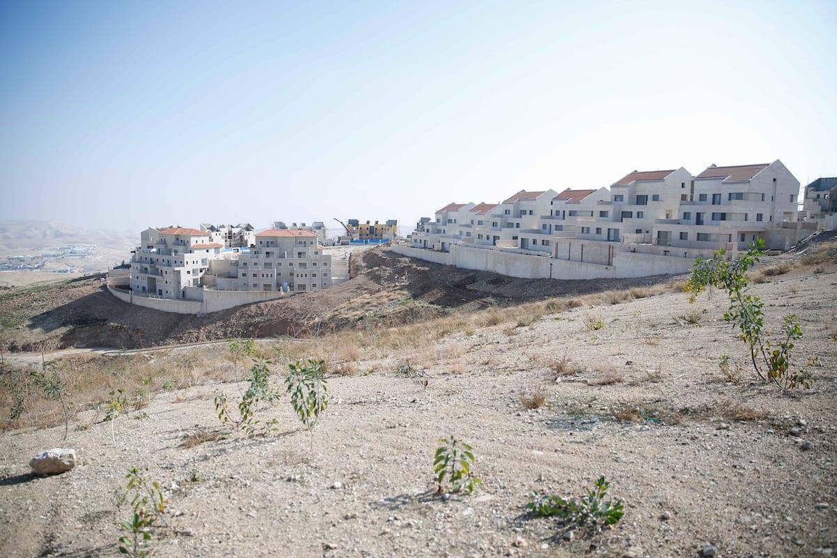 Israeli settlements, under construction are seen, in Palestinian lands in Jerusalem, on December 29, 2016 [Daniel Bar On / Anadolu Agency]
