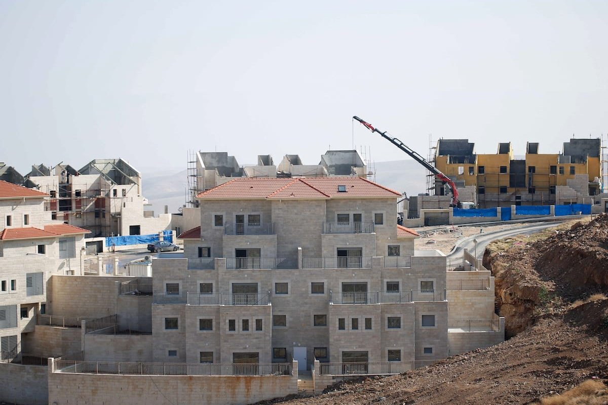 Illegal Israeli settlements, under construction are seen, in Palestinian lands in Jerusalem, on December 29, 2016. Settlement constructions by Israel continue in Ramat Shlomo, [Daniel Bar On/Anadolu Agency]