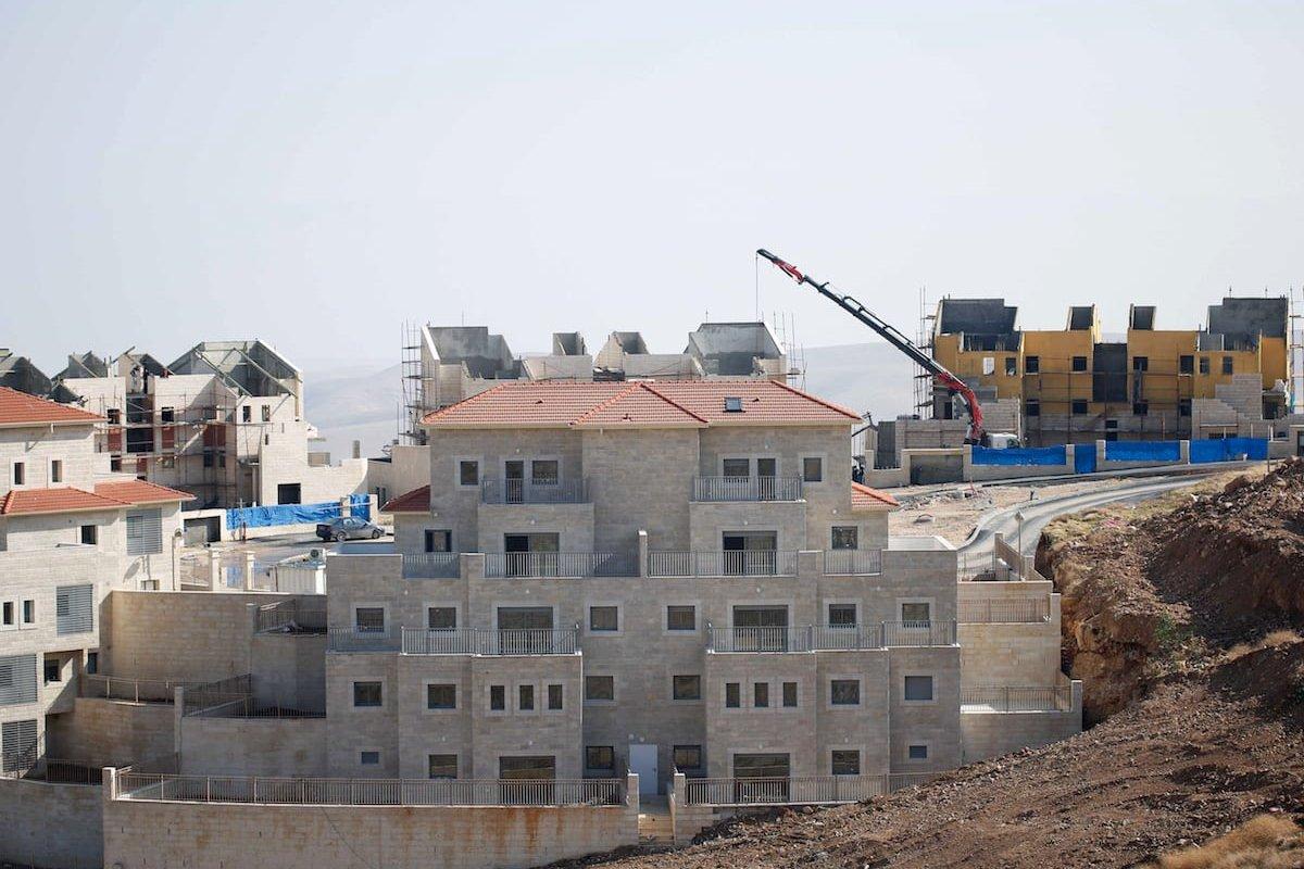 Illegal Israeli settlements, under construction are seen, in Palestinian lands in Jerusalem, on December 29, 2016. Settlement constructions by Israel continue in Ramat Shlomo, [Daniel Bar On/Anadolu Agency]