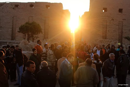 Tourists gather to watch the sunrise on the day of the winter solstice in Egypt on 21 December 2016 [Anadolu Agency]